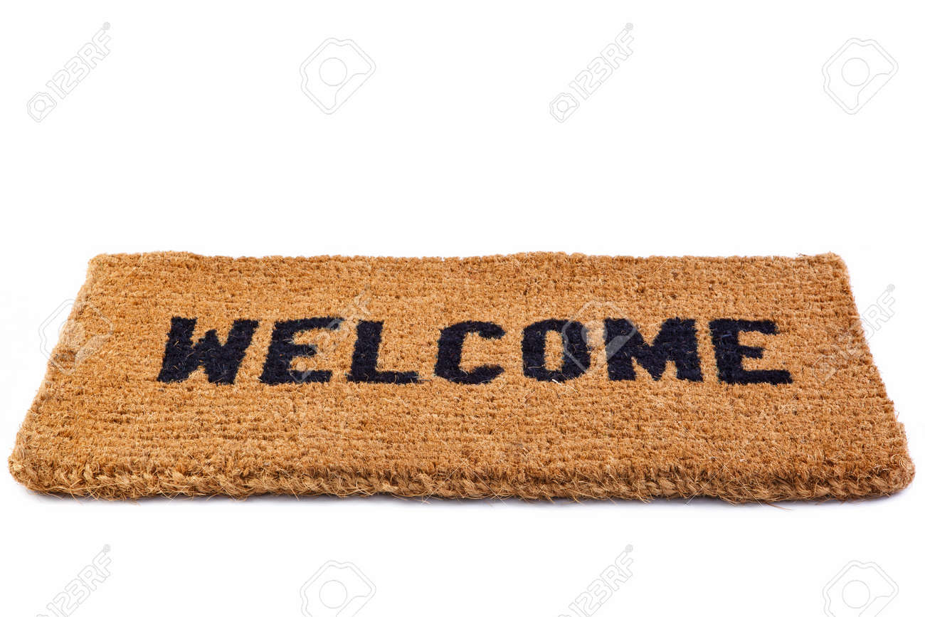 welcome mat a welcome door mat isolated on a white background stock photo
