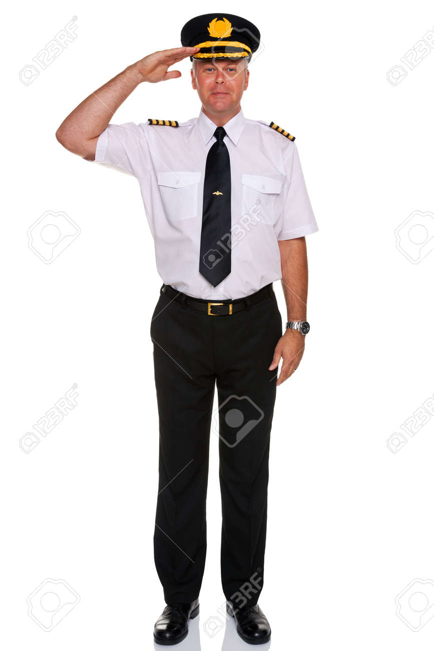 an airline pilot wearing the four bar Captains epaulettes saluting, isolated on a white background. Stock Photo - 10058854