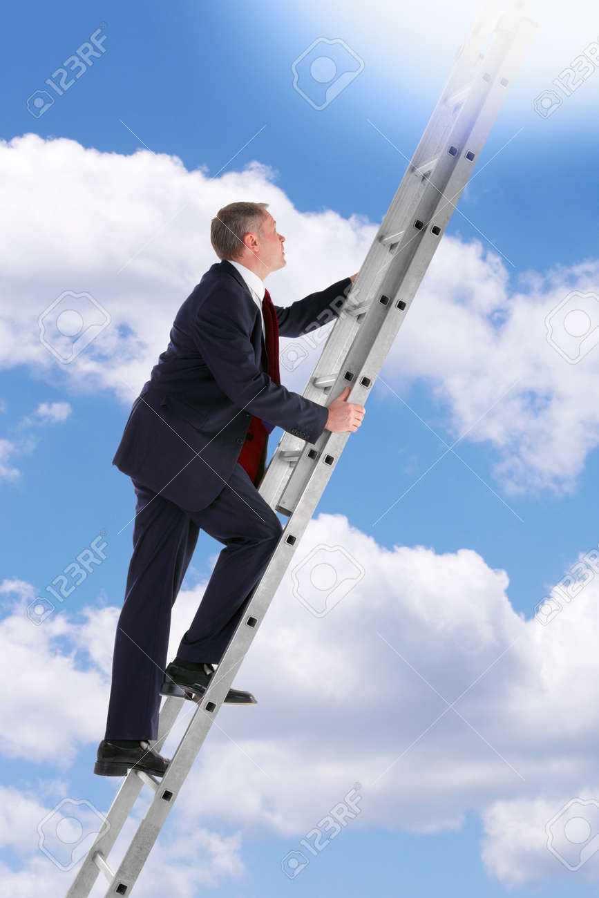 Concept photo of a businessman climbing a ladder into the sky looking up into the light. Stock Photo - 10058874