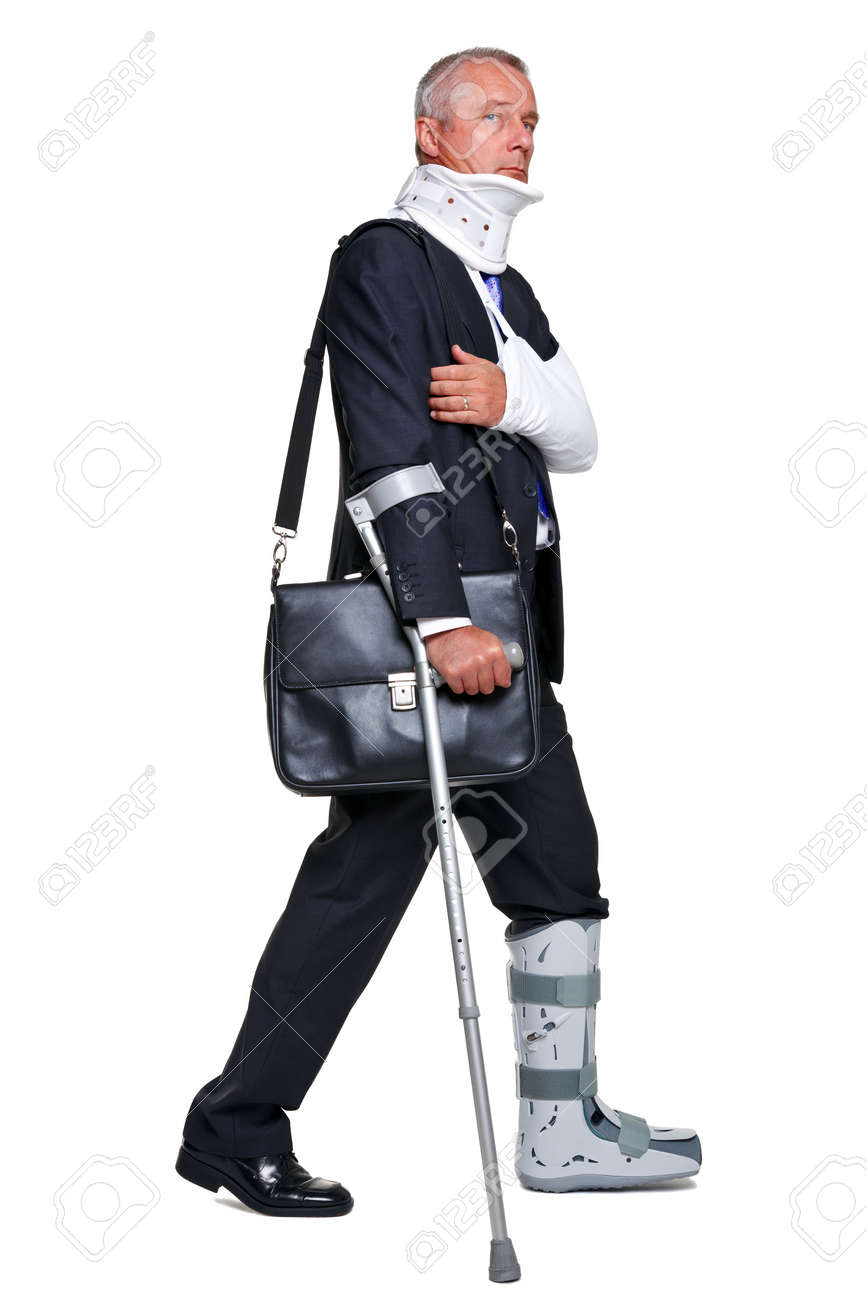 Badly injured businessman walking on cructhes carrying a briefcase, isolated on a white background. Stock Photo - 10134554