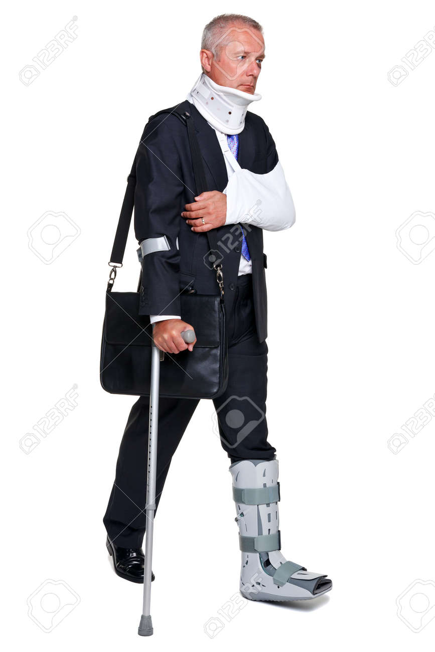 Badly injured businessman walking on cructhes carrying a briefcase, isolated on a white background. Stock Photo - 10134552