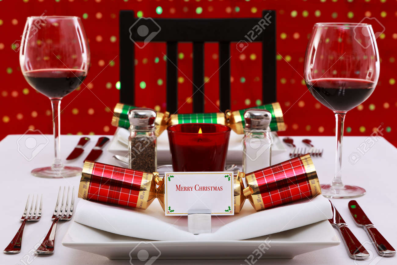 Photo of a restaurant table with christmas place settings with photo of a restaurant table with christmas place settings with crackers and name card the solutioingenieria Images