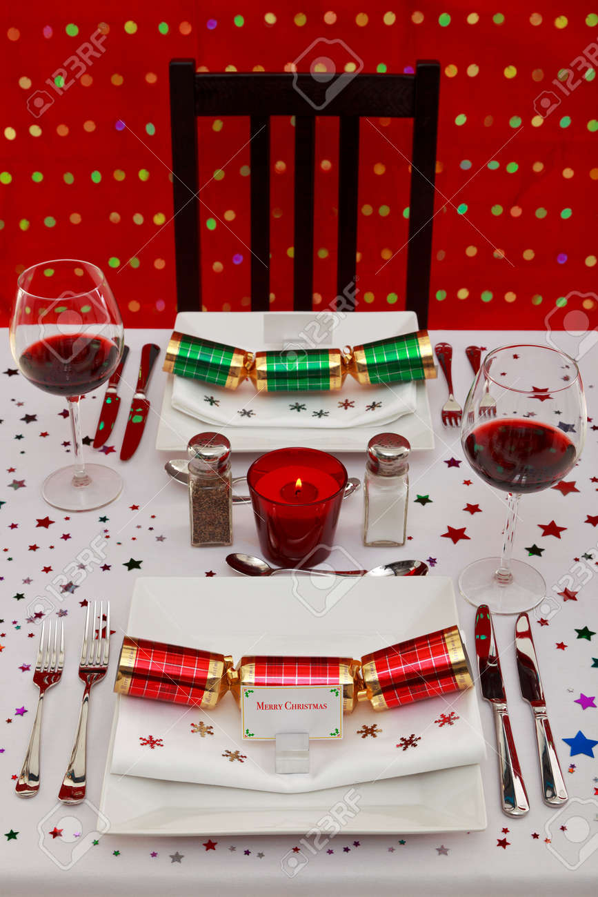 Photo of a restaurant table with christmas place settings tha photo of a restaurant table with christmas place settings tha name card was designed by solutioingenieria Images