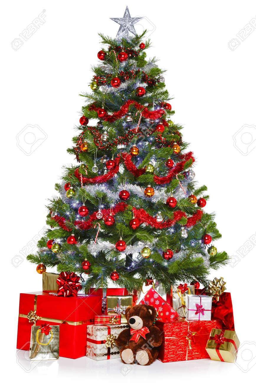 Foto Van Een Kerstboom Met Versieringen En Verlichting, Omringd Door ...