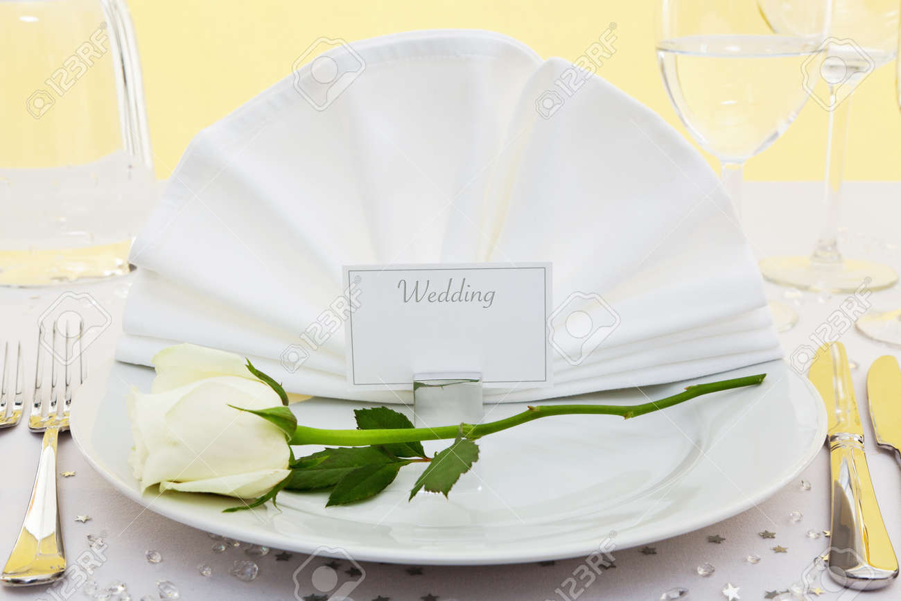 Photo of a table place setting for a wedding with a white rose on the plate & Photo Of A Table Place Setting For A Wedding With A White Rose ...