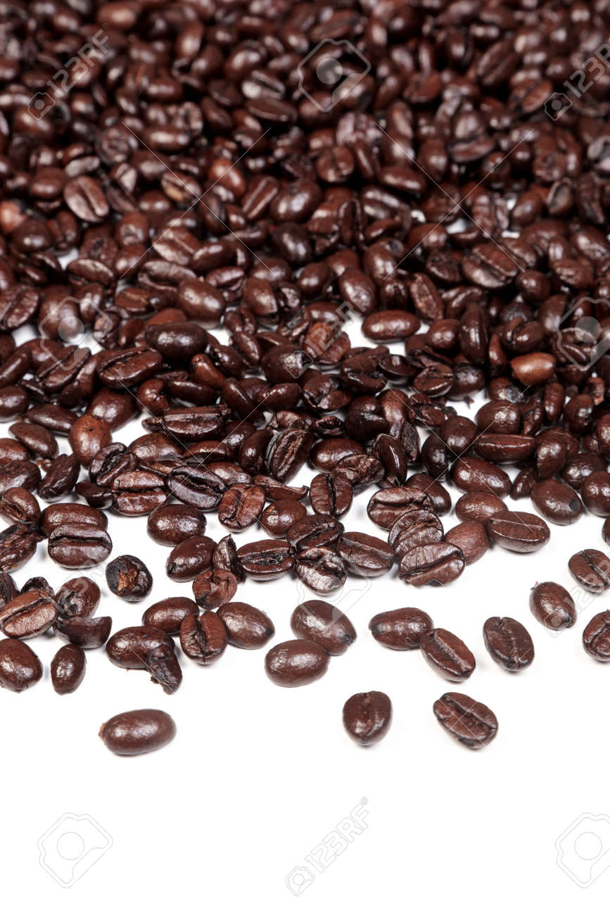 Photo of an Arabica and Robusta coffee beans mixture on a white background. Stock Photo - 13508353
