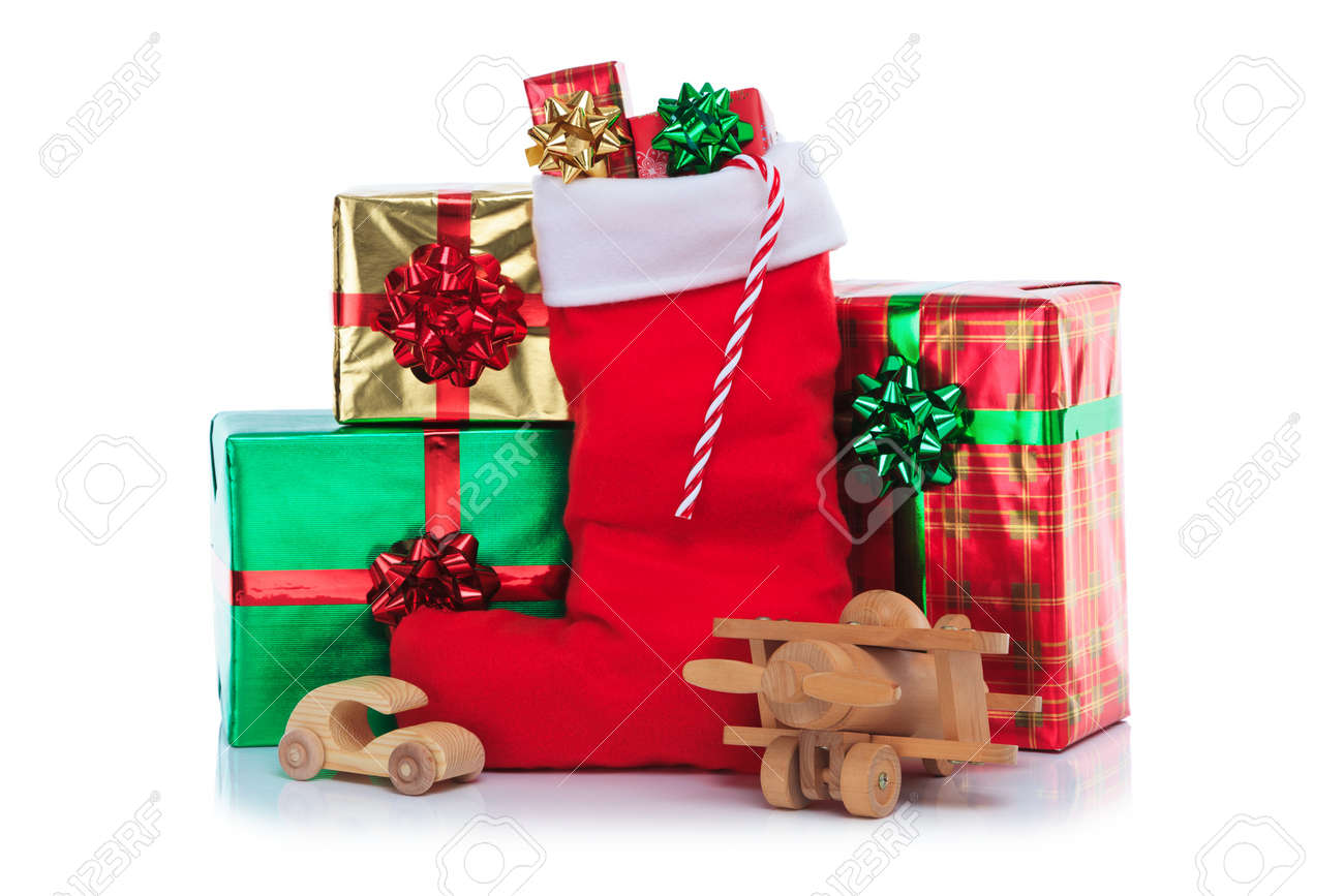 Photo of a red christmas stocking with gift wrapped presents photo of a red christmas stocking with gift wrapped presents and toys isolated on a negle Choice Image