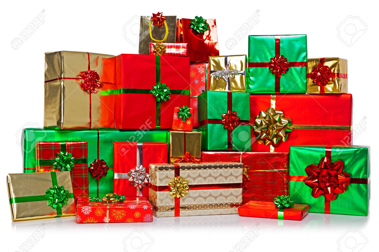 A large group of gift wrapped Christmas presents in a colourful variety of wrapping paper with ribbons and bows, isolated on a white background. - 16379868