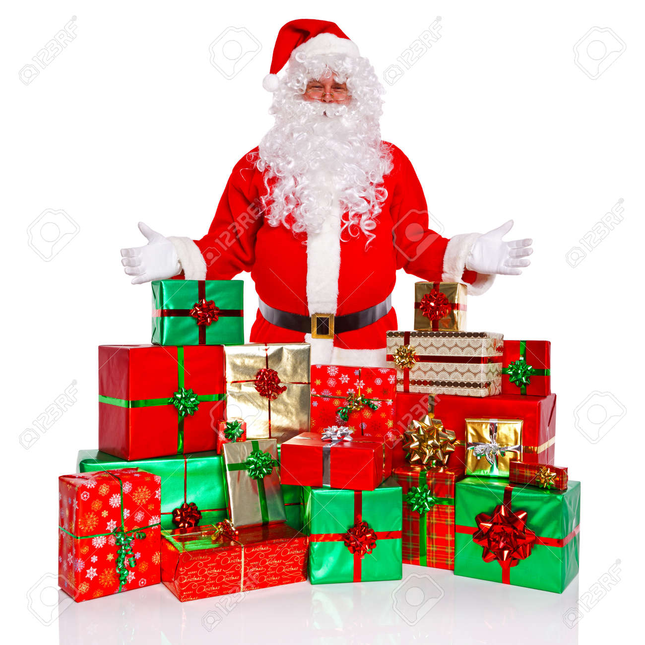Santa claus or father christmas standing with a large collection santa claus or father christmas standing with a large collection of gift wrapped presents isolated negle Images