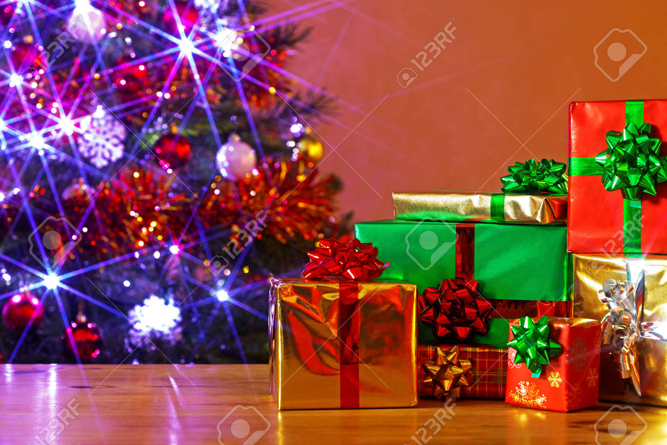 Gift Wrapped Christmas Presents On A Table And A Decorated Tree Stock Photo Picture And Royalty Free Image Image 16663274