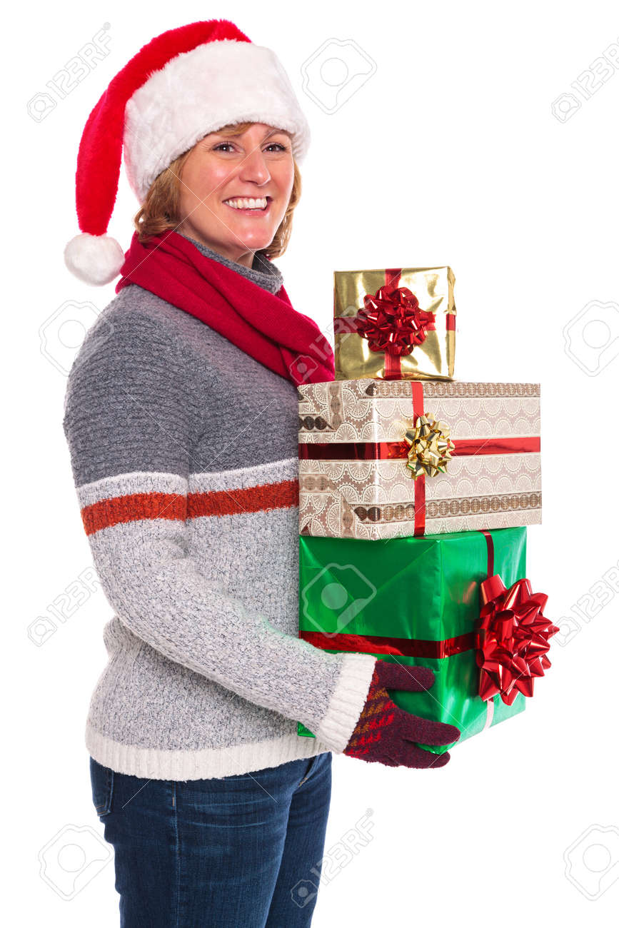 A woman wearing a Santa Claus hat holding some gift wrapped Christmas presents, isolated on a white background. Stock Photo - 16762814