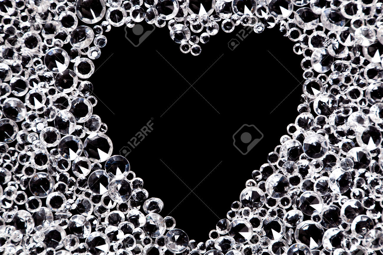 Hundreds of imitation diamonds on a black background with a heart shaped space in the middle. Stock Photo - 16957133