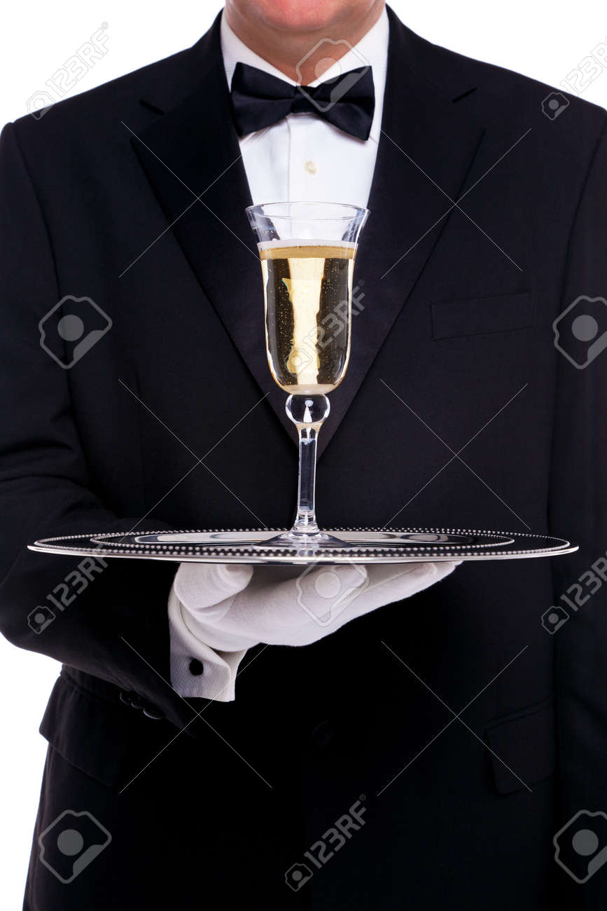 A butler serving a glass of champagne on a silver tray, on a white background. - 16987377