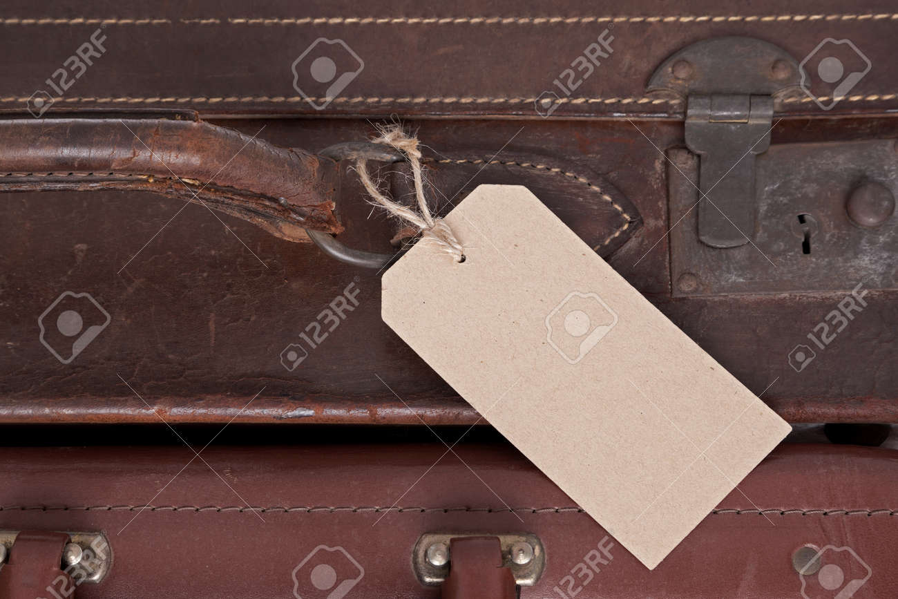 Photo of a blank baggage label on an old brown leather suitcase Stock Photo - 21015012
