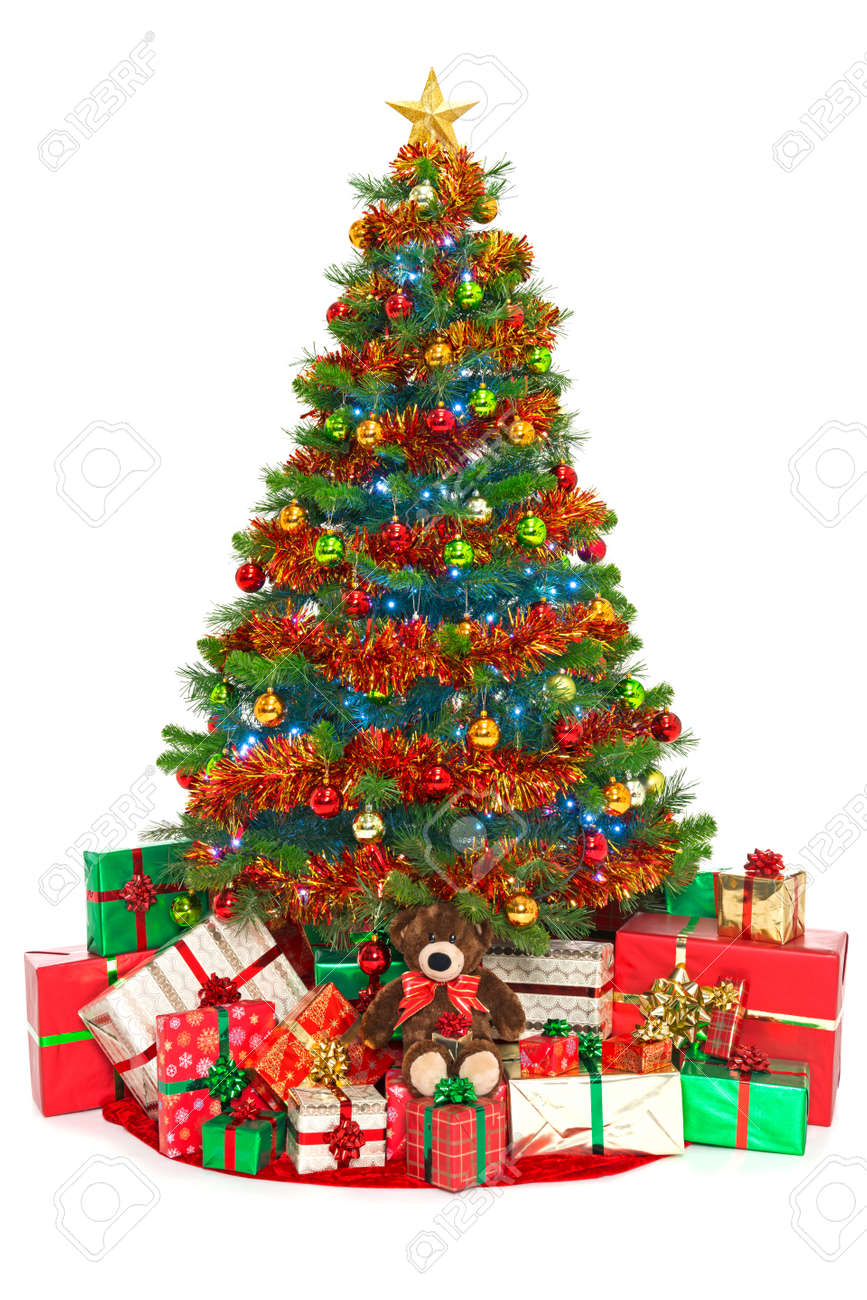 Christmas tree with decorations, baubles, tinsel and fairy lights surounded  by gift wrapped presents