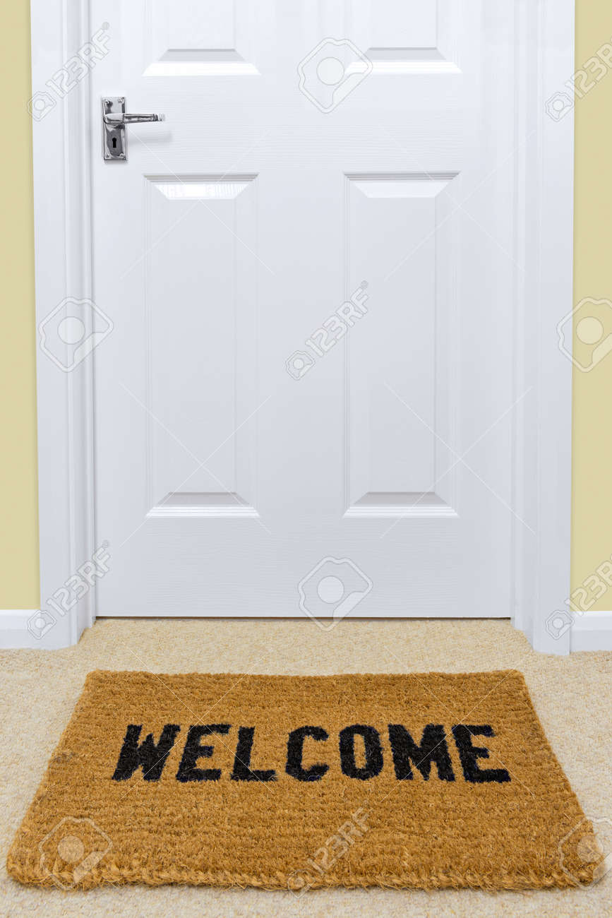A Welcome Doormat In Front Of A Door. Stock Photo, Picture And ...