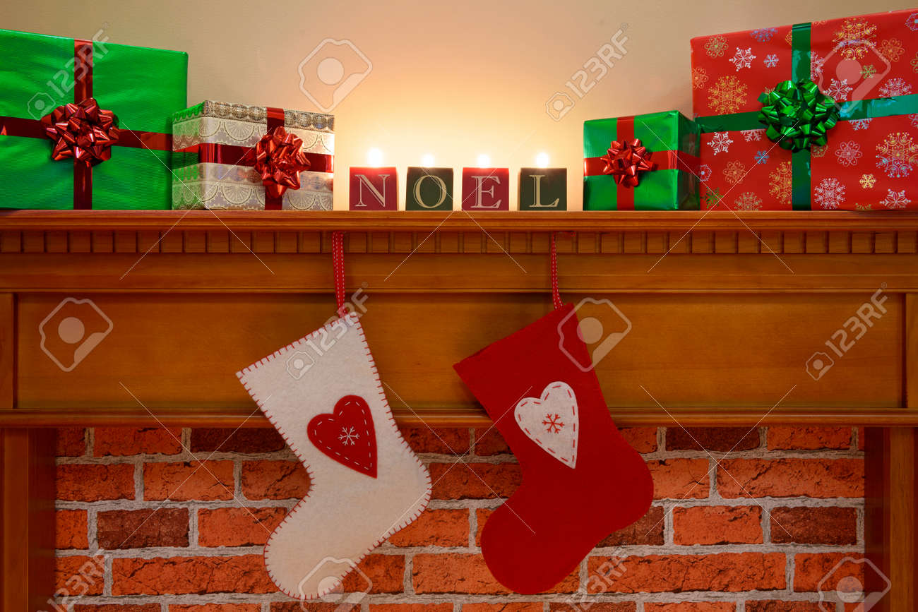 christmas stockings hanging over the fireplace with gift wrapped