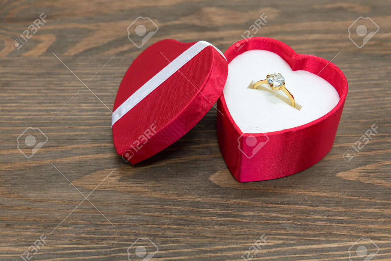 Diamond Engagement Ring In A Red Silk Heart Shaped Box Stock Photo   26040364