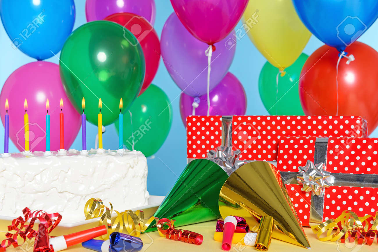 Birthday Party Still Life With Cake Balloons Presents Streamers And Hats Stock