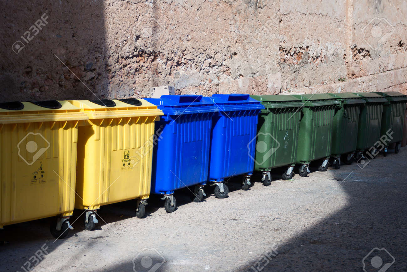 three type of plastic big trash recycling bins on the street Stock Photo - 14294124