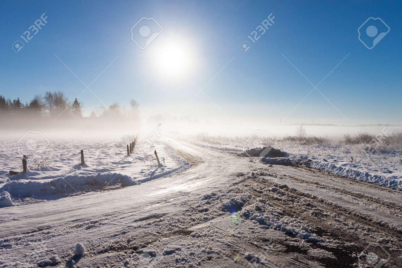winter landscape at fog  with road near farm Stock Photo - 16032804