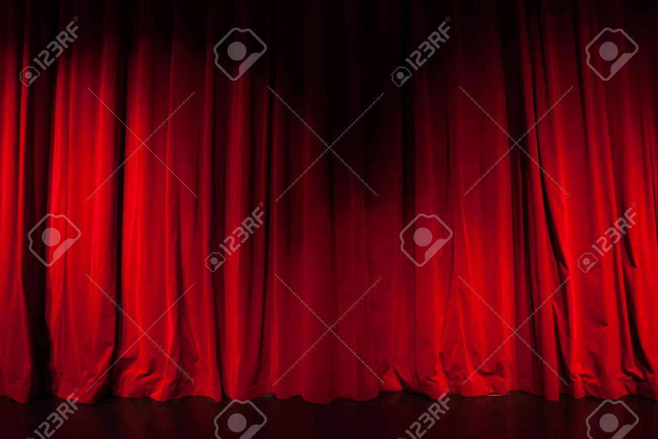 Curtain from the theatre with a spotlight as background - 20342276