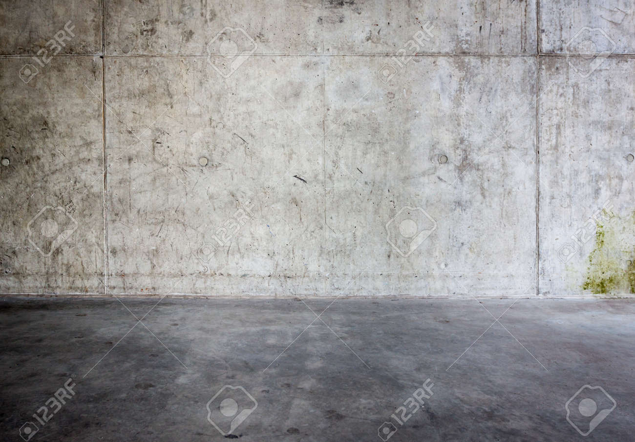 Mur de béton sale et le sol en arrière-plan