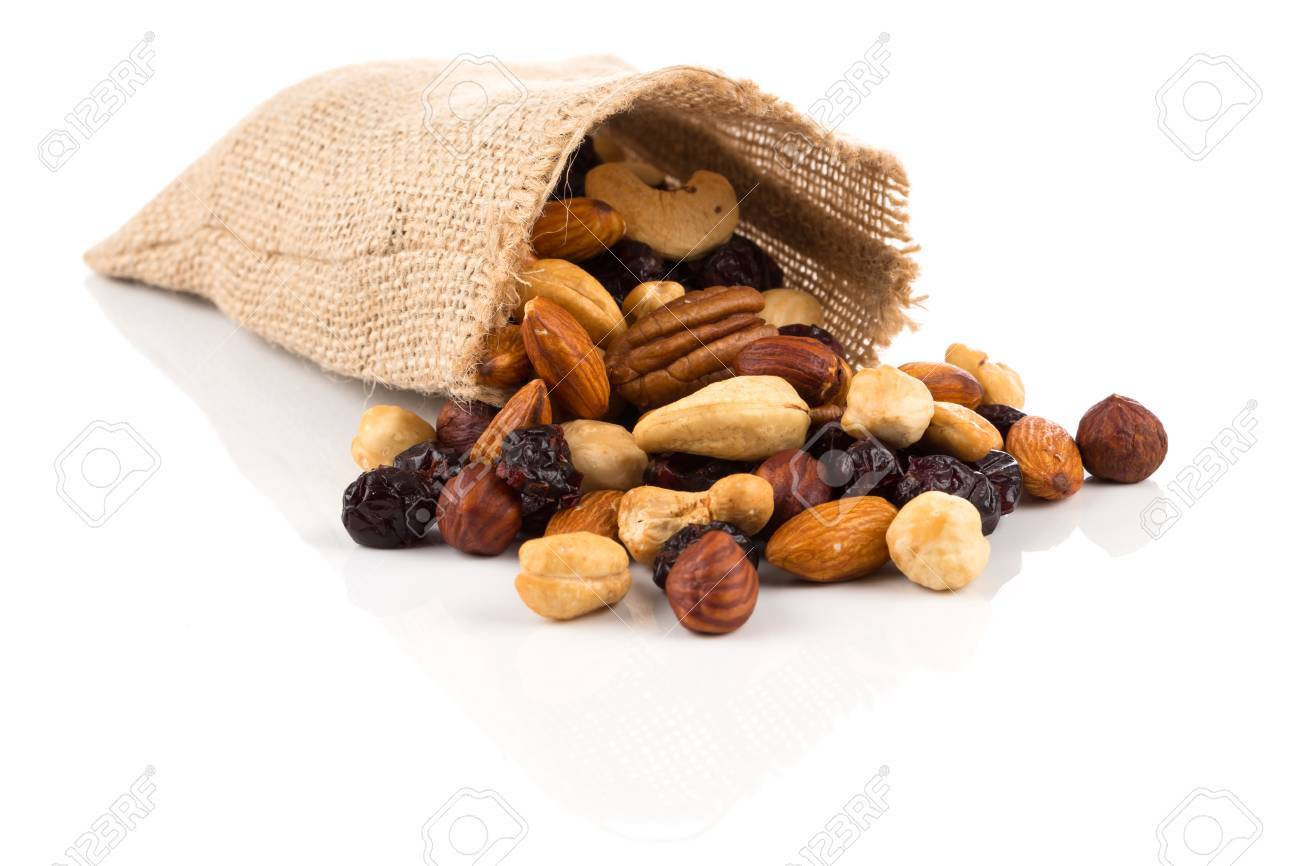 Mix nuts, dry fruits and grapes on a white background in hessian bag - 85093600