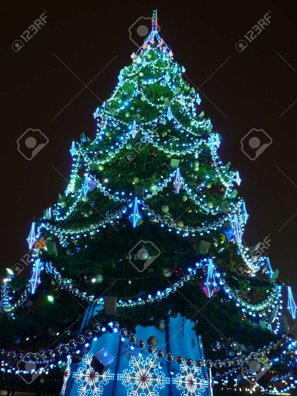 toys on green christmas firtree at night Stock Photo - 5558171