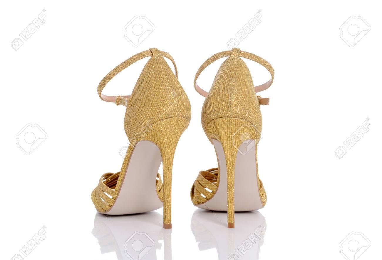 40b8b2d011fc an amazing yellow shiny shoes for women Stock Photo - 81686368