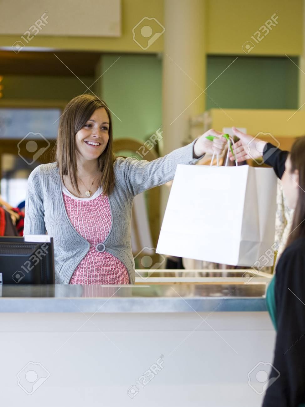 bf9545141eb Pregnant Clothing Store Clerk Stock Photo - 87497006