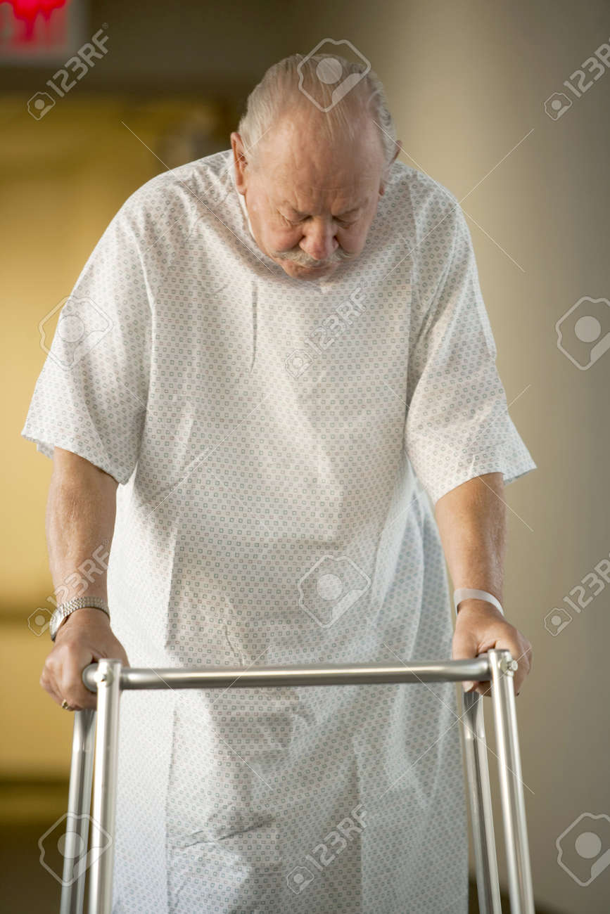 Mature Man In Hospital Gown With Walker Stock Photo, Picture And ...