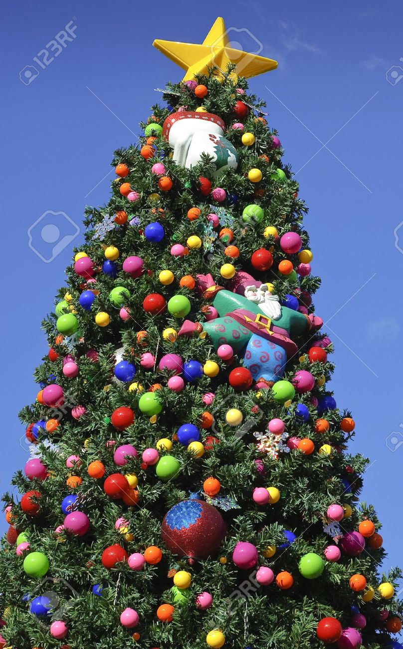 Outside ornaments - Christmas Tree Decorated With Bright Colorful Ornaments Outside Stock Photo 3873511