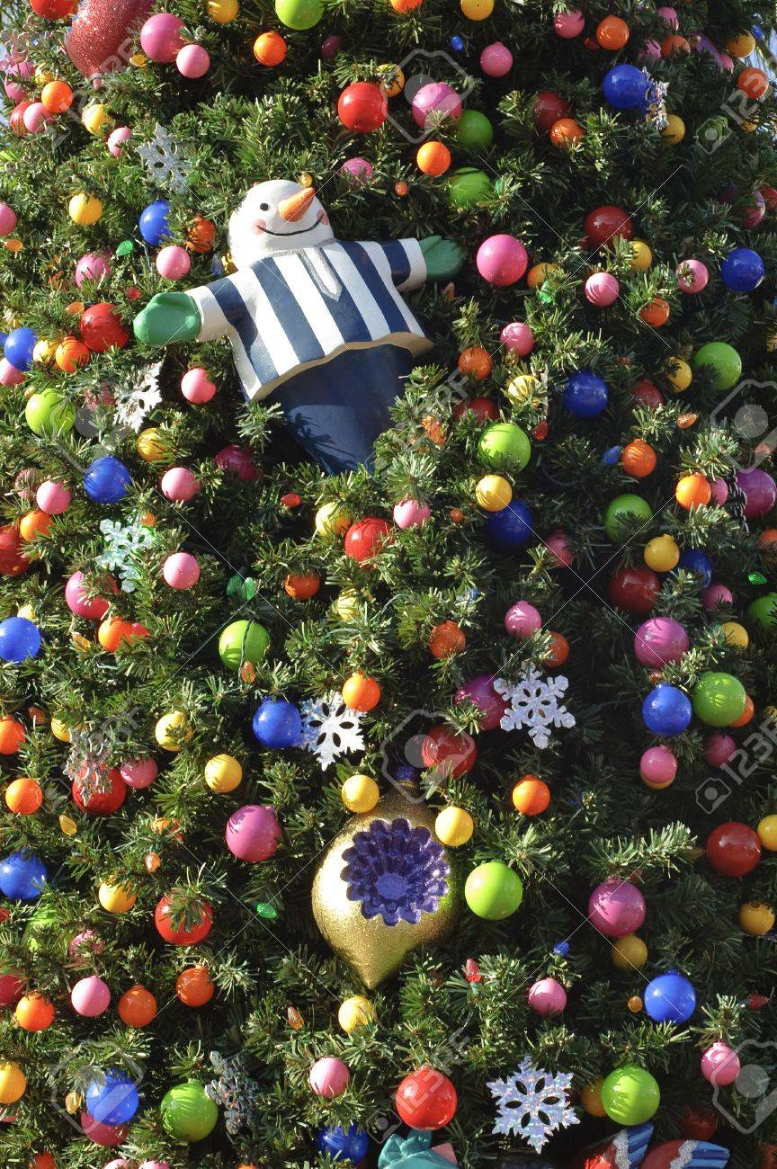 Outside ornaments - Close Up Of Christmas Tree Decorated With Ornaments Outside Stock Photo 3873512