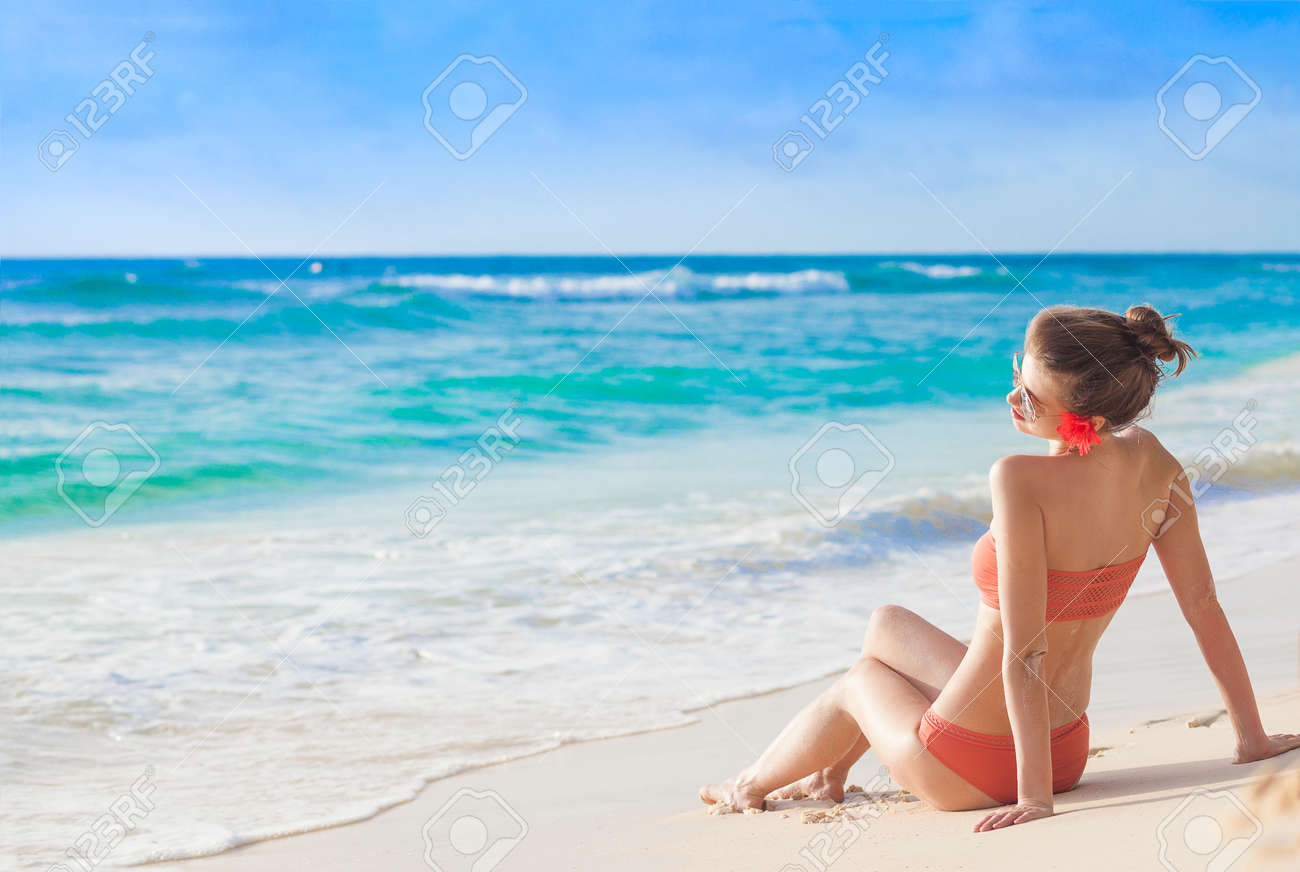 Portrait Of Woman In Bikini With Hibiscus Flower In Her Hair Stock