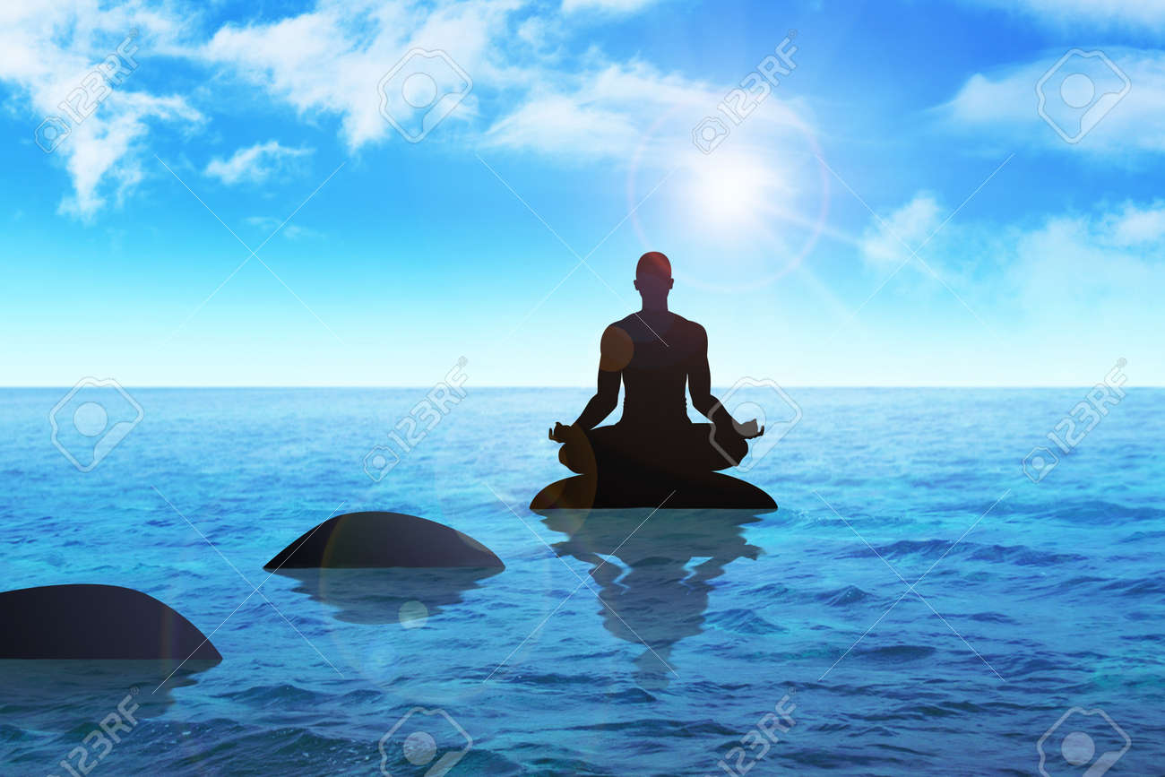 Silhouette of a man figure meditating on a stone Stock Photo - 15941946