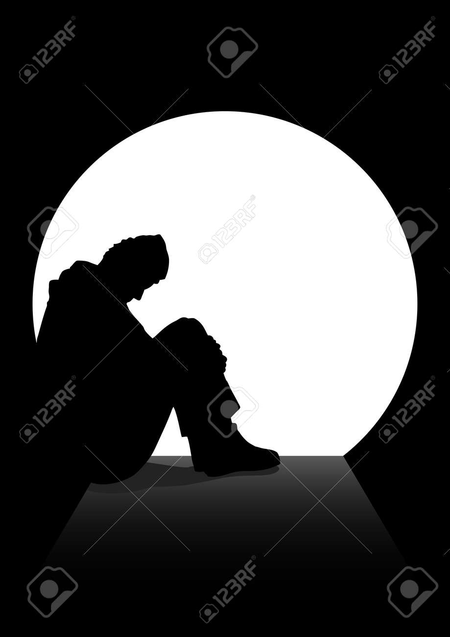 A man in silhouette sitting on the ground in a dark tunnel. Loneliness, depression, homeless, stressed, frustration theme - 50429805