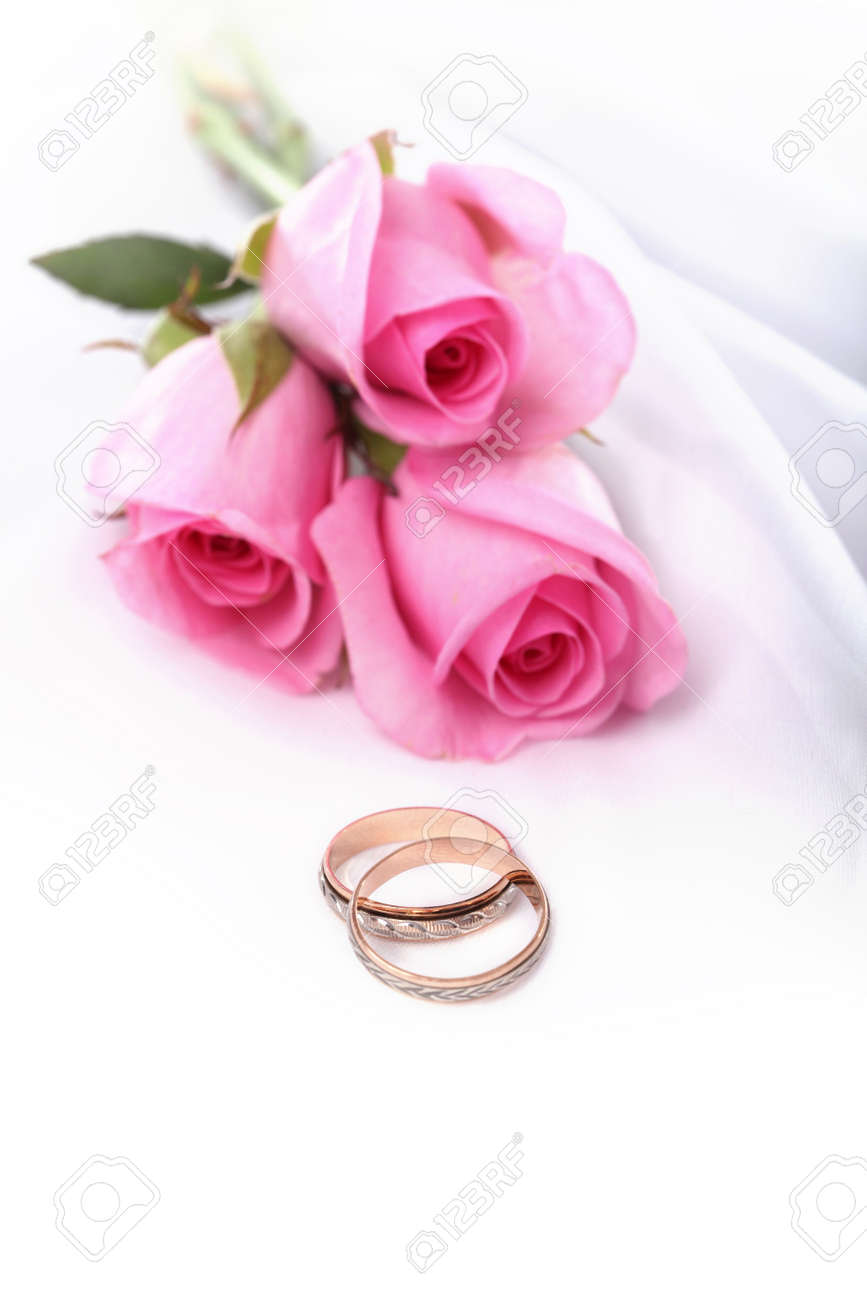 Wedding Rings And Pink Roses Stock Photo, Picture And Royalty Free ...