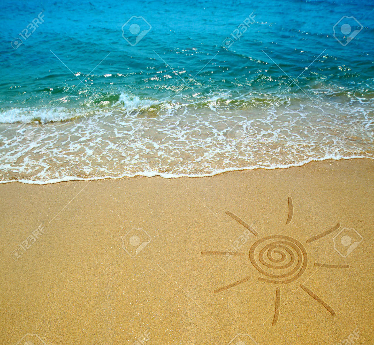 Sun Drawing On A Beach Stock Photo