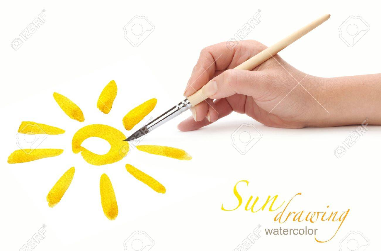 hand with brush drawing sun, isolated Stock Photo - 10480511
