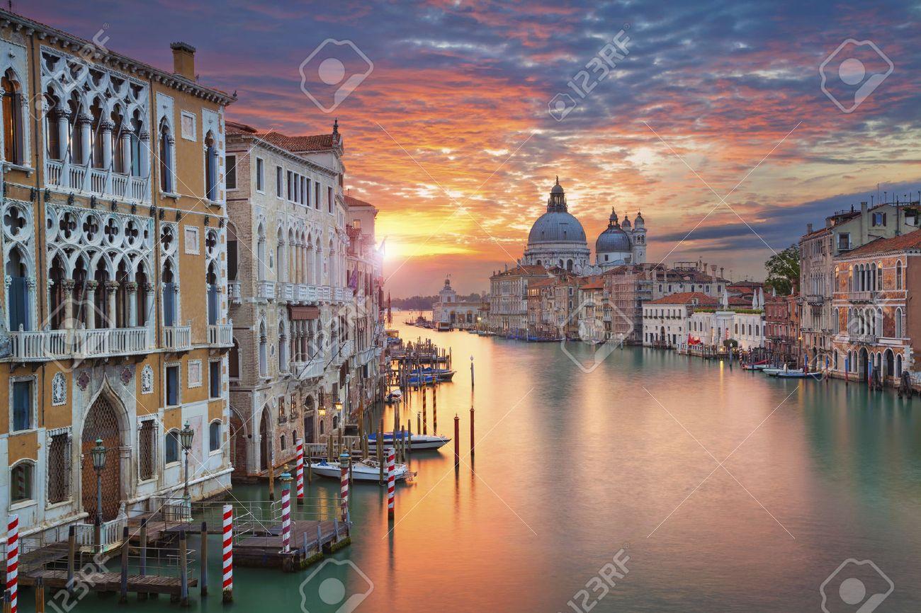 Venice. Image of Grand Canal in Venice, with Santa Maria della Salute Basilica in the background. - 46754742