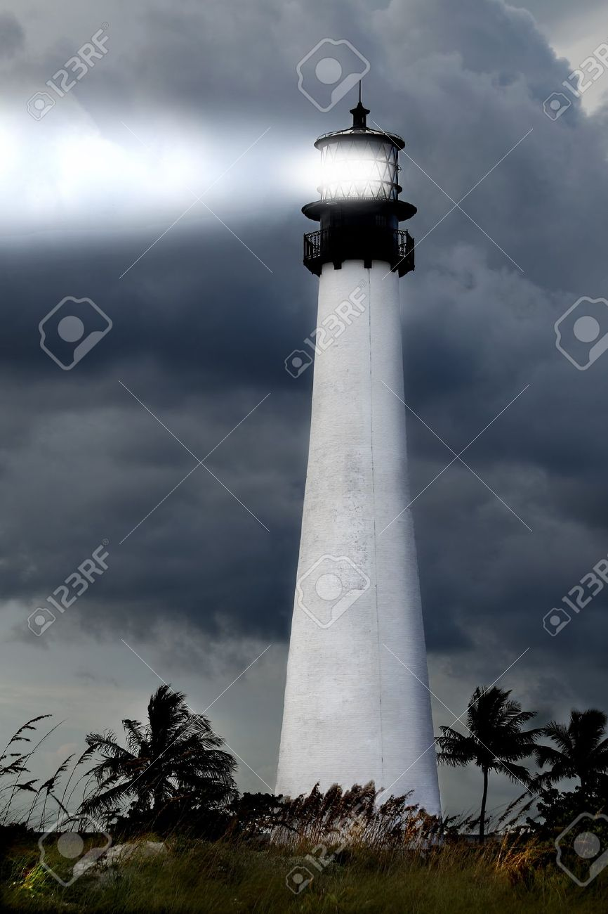 View of the Cape Florida lighthouse in the Bill Baggs State park during a stormy night on Key Biscayne in Miami Florida Stock Photo - 10906306