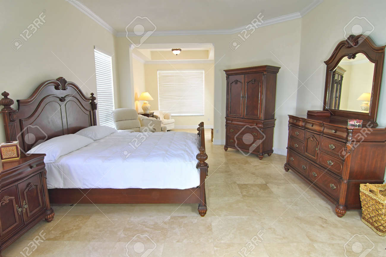 Overview Of A Beautiful Classic Bedroom Suite In A Private Residence With A  Travertine Floor Stock