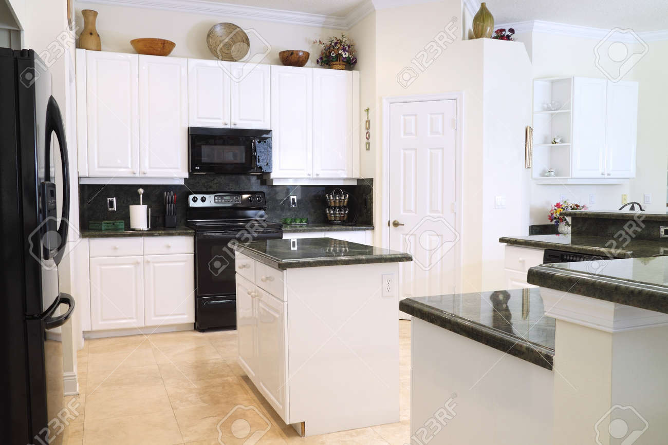 View Of A Beautiful Modern Kitchen With Upscale Appliances, White ...