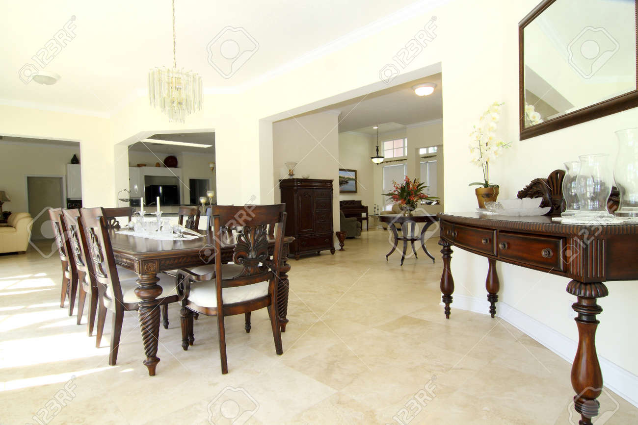 view of a beautiful classic rich dining room with travertine
