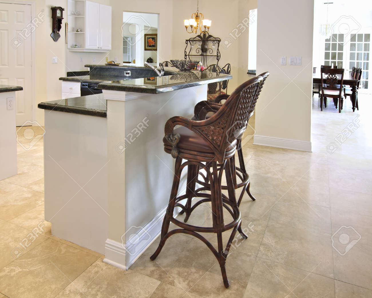 View Of A Beautiful Modern Kitchen Bar With Green Granite Counter Tops And  White Cabinets Stock