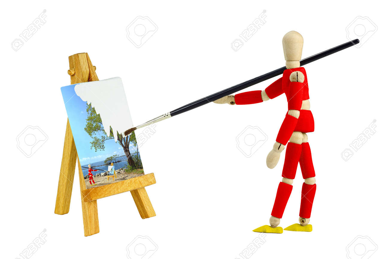 Wooden mannequin with an easel painting a landscape, isolated on white Stock Photo - 12408773