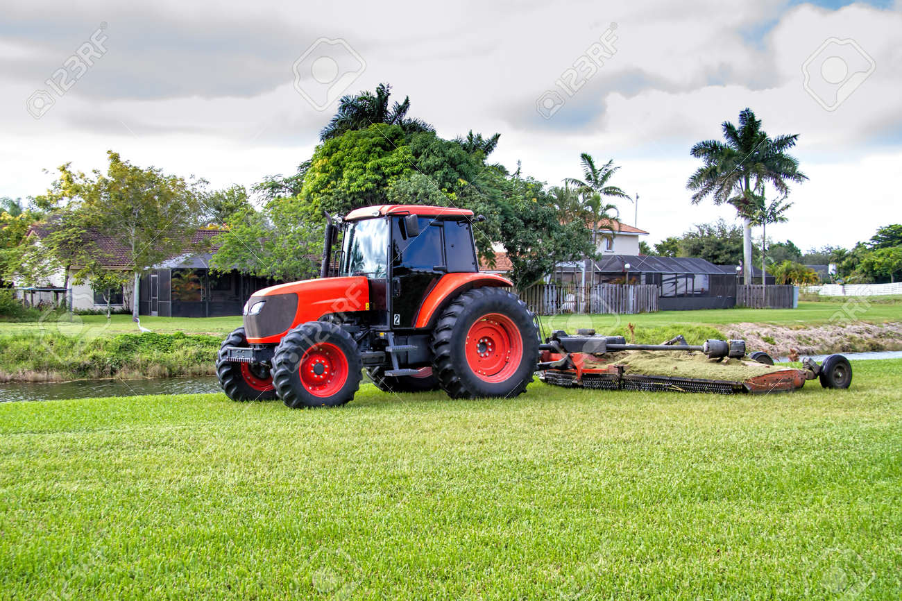 Lawn Mower Tractor >> Commercial Tractor Type Lawn Mower At Work In A Residential Area