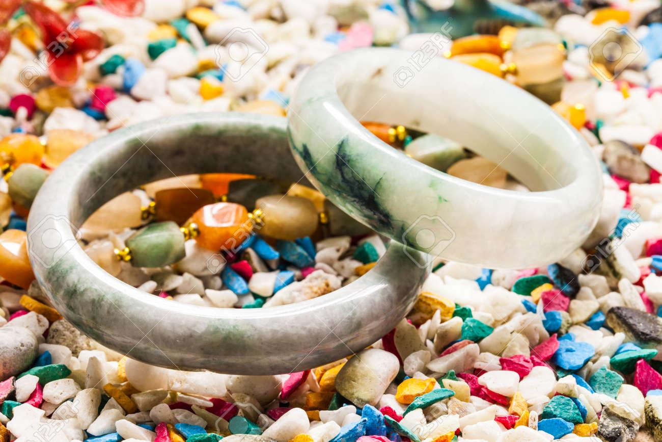 jade bracelet on stone background. - 30960179