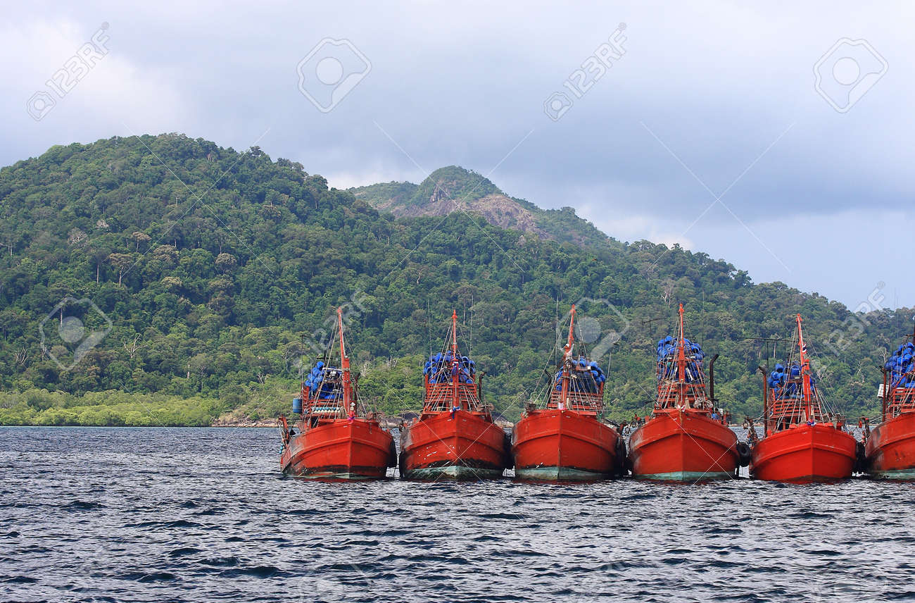 big red boat body floating in the andaman sea stock photo picture